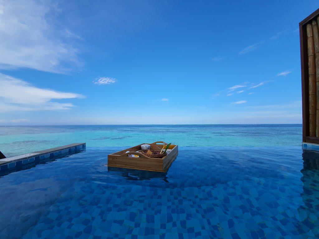 Water villa pool breakfast